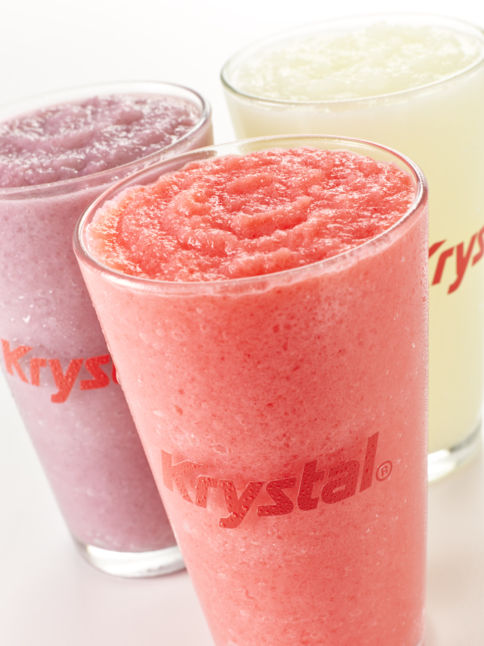 Raspberry, strawberry and citrus slushies in clear Krystal cups